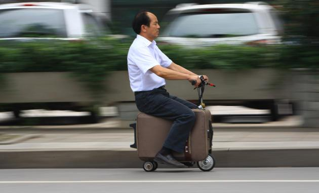 scooter with suitcase